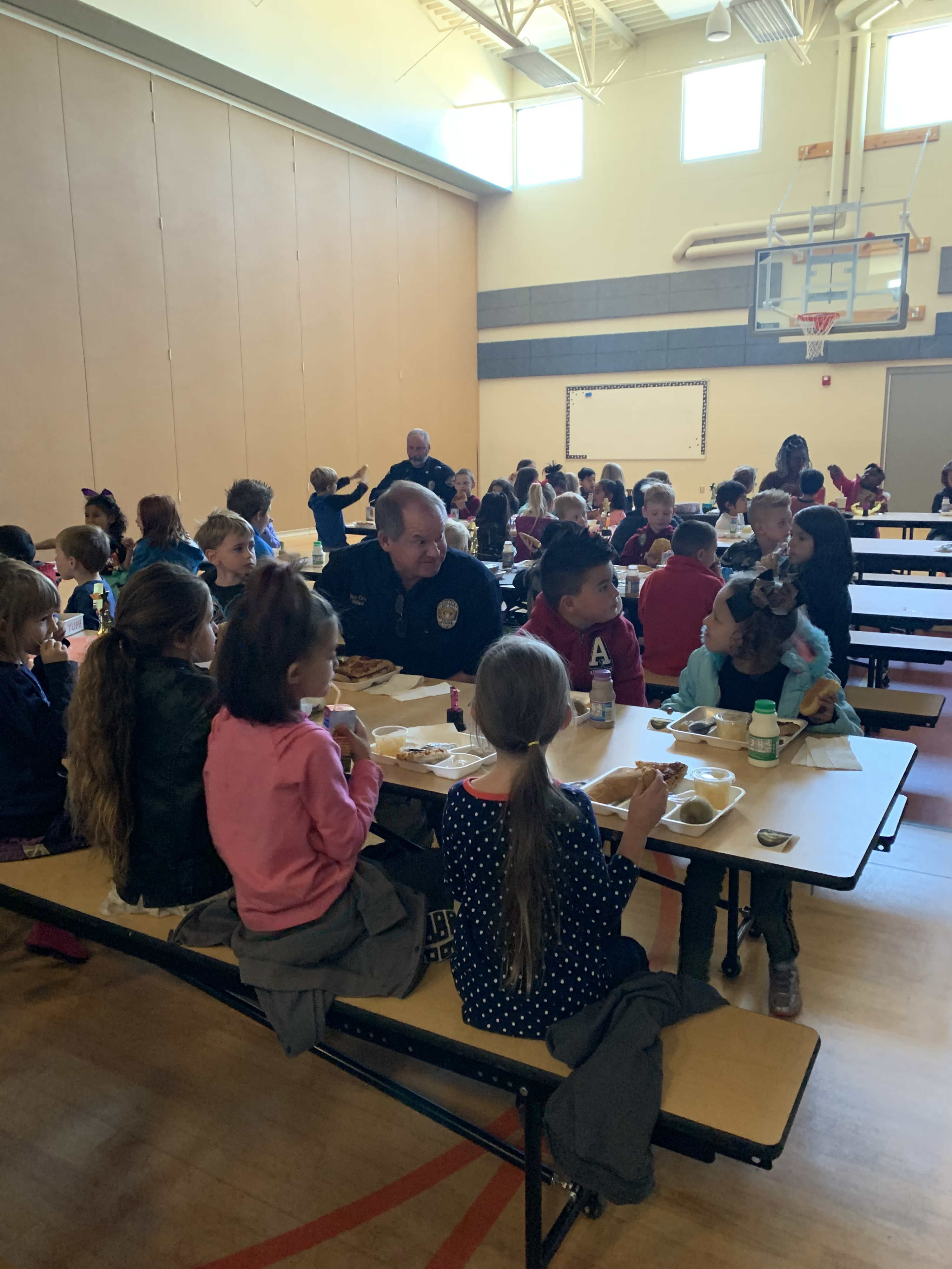 Kindergarteners with Roy City Police Department Eating Lunch
